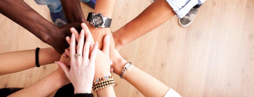 Team hand hold in support of business change and business transformation